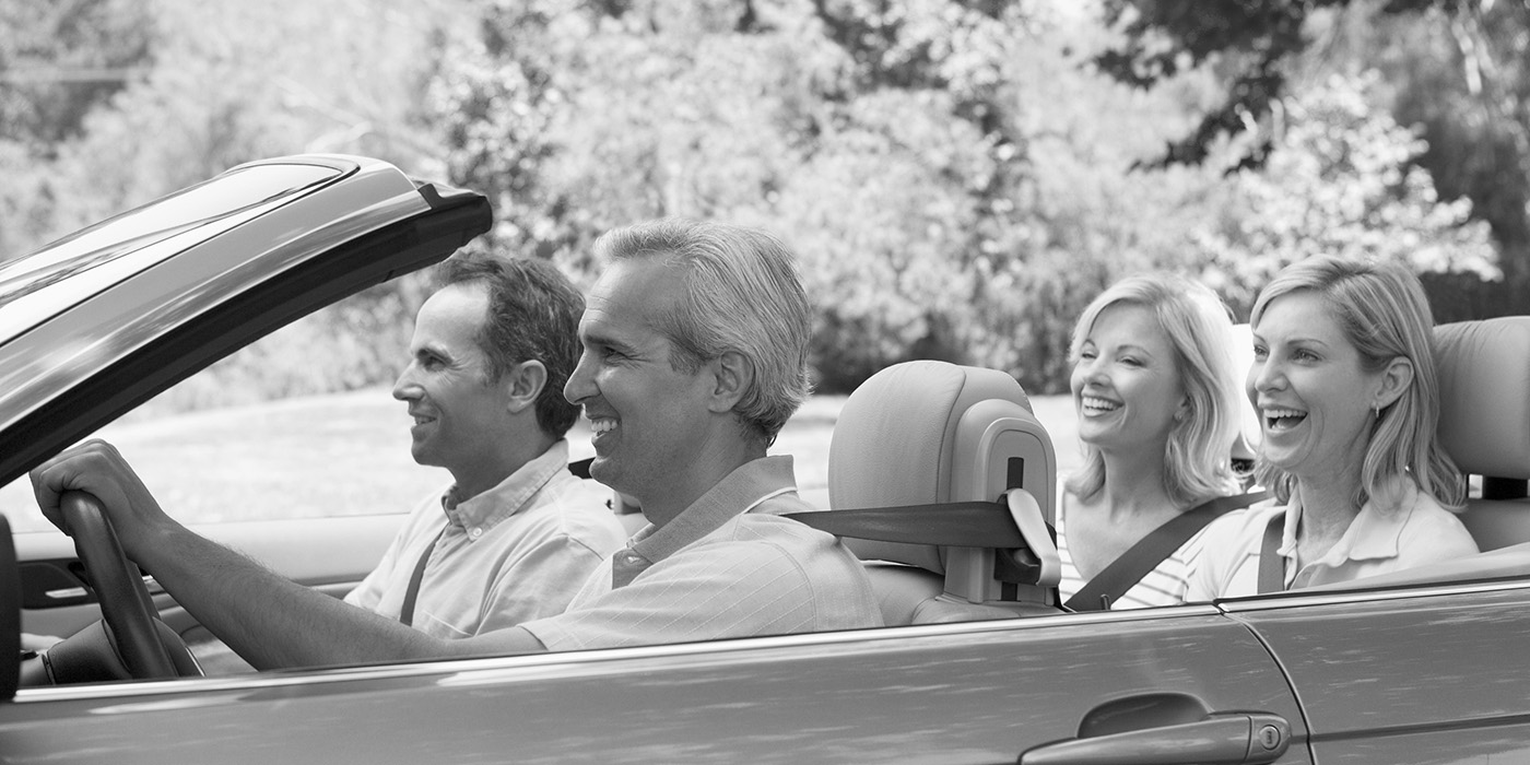 Two Couples in a convertible car